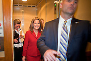 17 OCTOBER 2011 - PHOENIX, AZ:  MICHELE BACHMANN, a Republican candidate for US President, follows a member of security detail out of an elevator after she talked to members of the Arizona legislators at the State Capitol in Phoenix. Bachmann met with Republican Arizona legislators and Republican members of the state's Congressional delegation Monday morning to talk about illegal immigration and border security. During the meeting she pledged that if she were elected US President, she would construct a fence along the US - Mexico border.   PHOTO BY JACK KURTZ