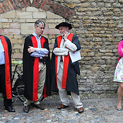 PIC BY GEOFF ROBINSON PHOTOGRAPHY 07976 880732.<br /> <br /> PIC SHOWS CAMBRIDGE UNIVERSITY DONS WAITING OUTSIDE THE SENATE HOUSE TO CONGRATULATE THEIR STUDENTS AFTER THEY RECEIVED THEIR DEGREES ON GRADUATION DAY JUNE 26TH.<br /> <br /> Students dressed in black gowns as the traditional Cambridge University graduation ceremonies took place today (Thurs).<br /> <br /> The students, from Gonville and Caius College and Trinity Hall paraded into the historic Senate House watched by family and friends to collect their degrees from the prestigious university.<br /> <br /> Many parts of the degree ceremonies, which will also be held tomorrow (Fri) and Saturday, have their origin amongst the earliest customs of the university 800 years ago.<br /> <br /> Undergraduates are required to wear the gown of their college and the hood of the degree they are about to receive.<br /> <br /> Mortarboards are optional for Cambridge graduates and if worn they must carry them into the Senate House.<br /> <br /> Gonville and Caius is one of the oldest and largest colleges at the world-renowned university.<br /> <br /> Alumni include Francis Crick, joint discoverer of the structure of DNA and Sir Howard Florey, developer of penicillin. Stephen Hawking is a current fellow of the college.<br /> <br /> SEE COPY  CATCHLINE Traditional Cam Uni graduations