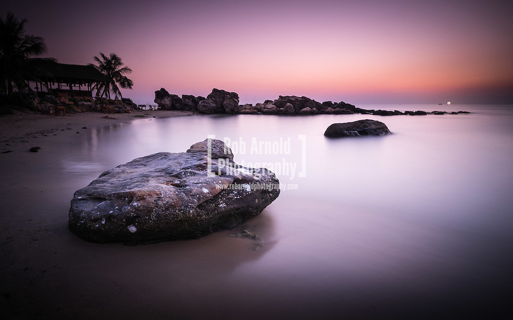 Sunset over rocks on Bai Truong (Long Beach) on the paradise island of Phu Quoc, southern Vietnam.
