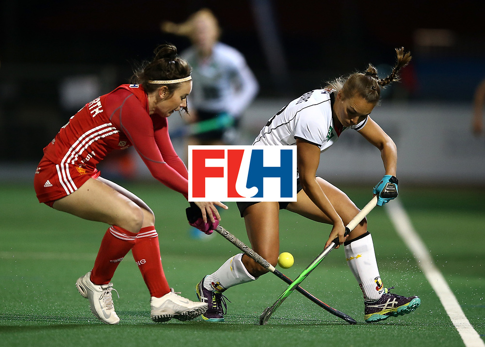 JOHANNESBURG, SOUTH AFRICA - JULY 14:  Laura Unsworth of England battles with Lisa Altenburg of Germany during day 4 of the FIH Hockey World League Women's Semi Finals Pool A match between Germany and England at Wits University on July 14, 2017 in Johannesburg, South Africa.  (Photo by Jan Kruger/Getty Images for FIH)