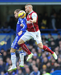Chelsea's Eden Hazard and Burnley's Michael Kightly compete for the ball - Photo mandatory by-line: Mitchell Gunn/JMP - Mobile: 07966 386802 - 21/02/2015 - SPORT - Football - London - Stamford Bridge - Chelsea v Burnley - Barclays Premier League