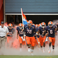 Syracuse Orange guard IVAN FOY (72) and Syracuse Orange safety RITCHY DESIR (6) lead the team onto the field to face the Stony Brook Seawolves at the Carrier Dome in Syracuse, New York. Stony Brook leads Syracuse 17-14 at the half.