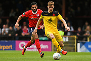 Joe Ironside of Kidderminster Harriers (9) holds up the ball with Hamza Bencherif of York City (4) at his back during the Vanarama National League match between York City and Kidderminster Harriers at Bootham Crescent, York, England on 15 September 2018.