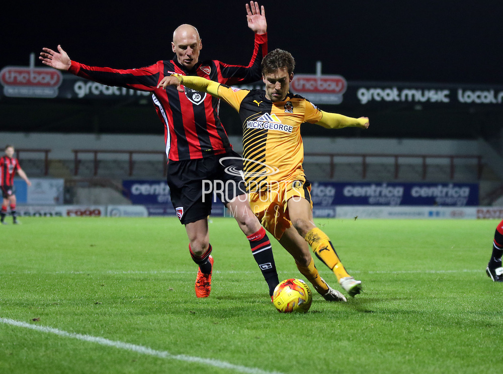 Kevin Ellison battle during the Sky Bet League 2 match between Morecambe and Cambridge United at the Globe Arena, Morecambe, England on 24 November 2015. Photo by Pete Burns.