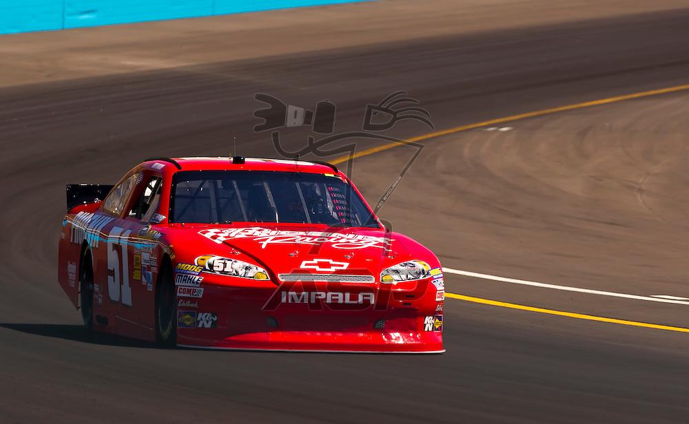AVONDALE, AZ - MAR 03, 2012:  Kurt Busch (51) brings his NASCAR Sprint Cup car through turn 4 during qualifying for the Subway Fresh Fit 500 race at the Phoenix International Raceway in Avondale, AZ.
