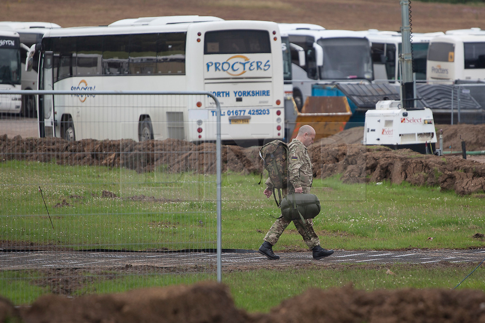 © licensed to London News Pictures. London, UK 18/07/2012. A soldier arrives to the military base in Hainault Country Park in Redbridge, east London. The base will accommodate 3,000 soldiers during the Olympics. Photo credit: Tolga Akmen/LNP