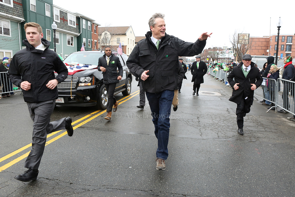 (Boston, MA - 3/15/15) Gov. Charlie Baker and his staff sprint along the route of the St. Patrick's Day Parade in South Boston, Sunday, March 15, 2015. Staff photo by Angela Rowlings.