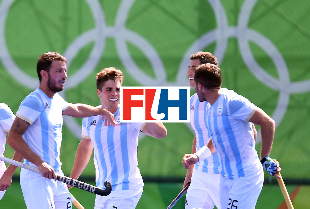 Argentina's Gonzalo Peillat (2nd L) celebrates his second goal during the men's semifinal field hockey Argentina vs Germany match of the Rio 2016 Olympics Games at the Olympic Hockey Centre in Rio de Janeiro on August 16, 2016. / AFP / MANAN VATSYAYANA        (Photo credit should read MANAN VATSYAYANA/AFP/Getty Images)