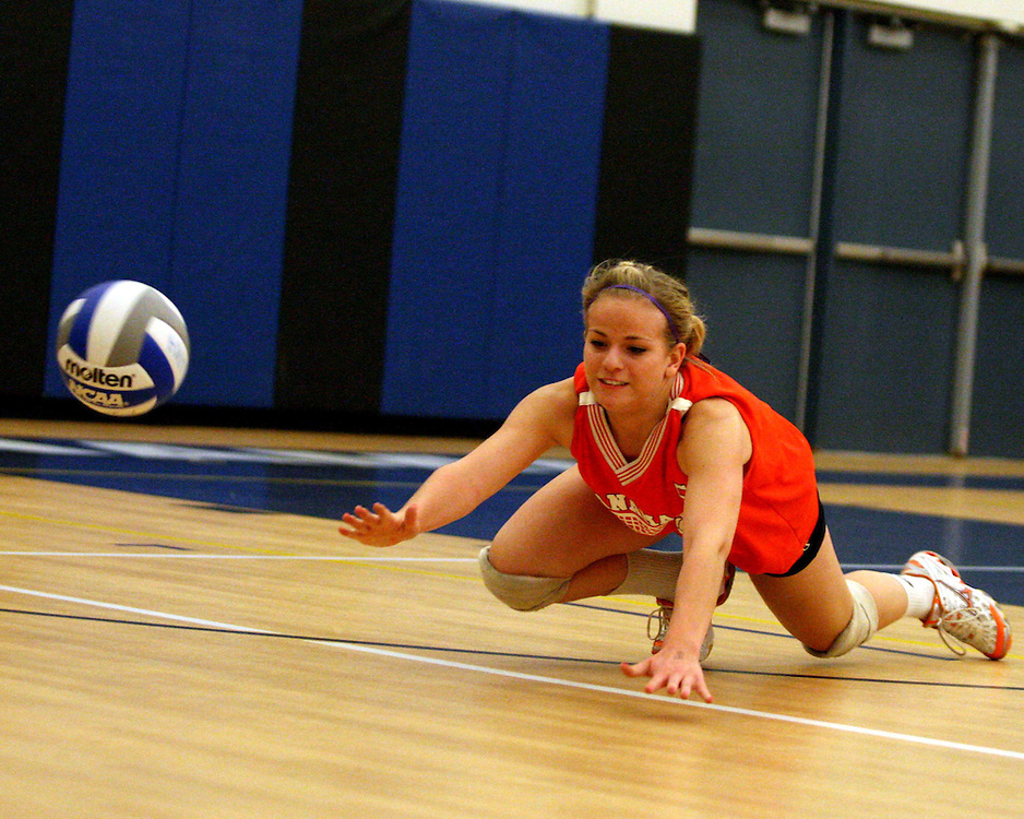 Panama's Randi Bilinski dives for ball during volleyball action against Portville 10-23 photo by Mark L. Anderson