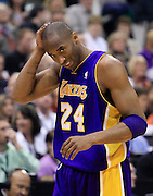 Los Angeles Lakers guard Kobe Bryant reacts after getting elbowed in the head by Utah Jazz center Kyrylo Fesenko during the first half of Game 4 of the NBA Western Conference second-round playoff series in Salt Lake City, Monday, May 10, 2010. (AP Photo/Colin E Braley)