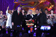 Hoda Kotb, New York City Mayor Bill de Blasio, Al Roker, Jerry Speyer, Rob Speyer and Lester Holt, left to right, light the 2017 Rockefeller Center Christmas Tree, Wednesday, Nov. 29, 2017, in New York. (Diane Bondareff/AP Images for Tishman Speyer)