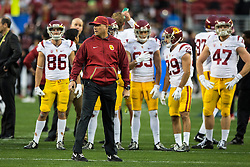 SANTA CLARA, CA - DECEMBER 05:  Head coach Clay Helton of the USC Trojans watches his team during warmups before the Pac-12 Championship game against the Stanford Cardinal at Levi's Stadium on December 5, 2015 in Santa Clara, California. (Photo by Jason O. Watson/Getty Images) *** Local Caption *** Clay Helton