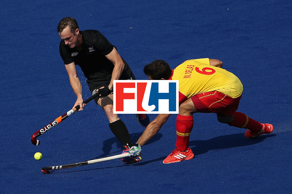 RIO DE JANEIRO, BRAZIL - AUGUST 09:  Hugo Inglis #29 of New Zealand moves the ball past Miguel Delas #6 of Spain during the hockey game on Day 4 of the Rio 2016 Olympic Games at the Olympic Hockey Centre on August 9, 2016 in Rio de Janeiro, Brazil.  (Photo by Christian Petersen/Getty Images)