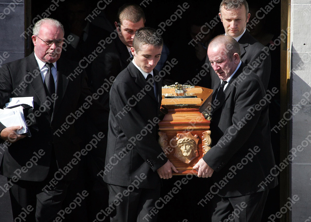 290805<br />The coffin of Ann Walsh leaving  St Sennans Church Kilrush Co Clare after her funeral mass on Monday Morning ( father Stephen front right).Pic Arthur Ellis/Press 22.