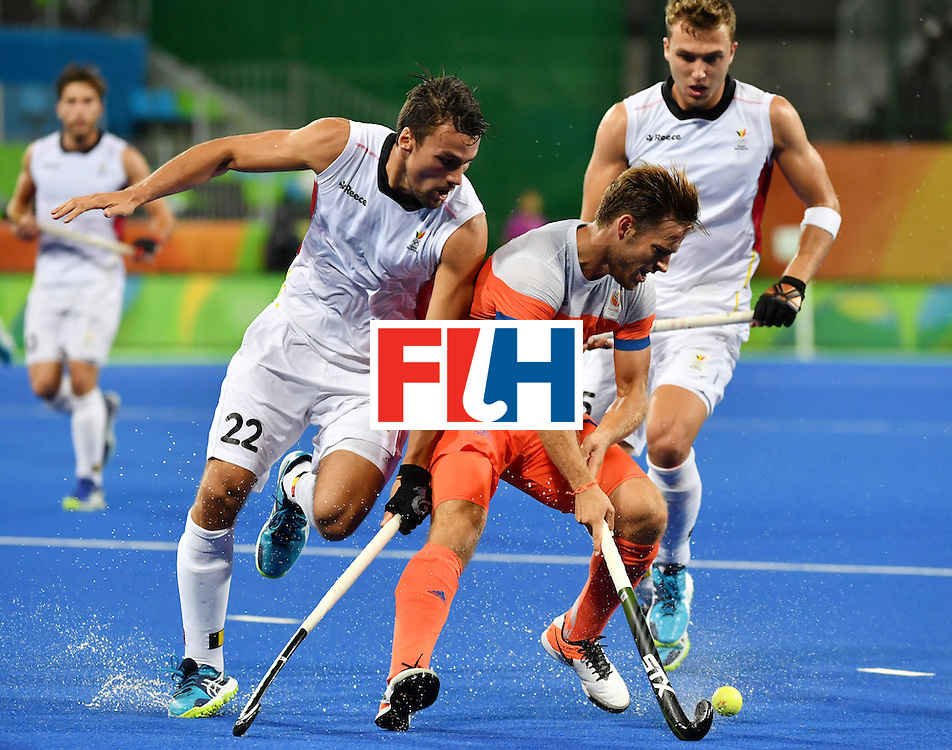Netherland's Jeroen Hertzberger (C) vies with Belgium's Simon Gougnard (L) and Belgium's Emmanuel Stockbroekx during the men's semifinal field hockey Belgium vs Netherlands match of the Rio 2016 Olympics Games at the Olympic Hockey Centre in Rio de Janeiro on August 16, 2016.  / AFP / Pascal GUYOT        (Photo credit should read PASCAL GUYOT/AFP/Getty Images)