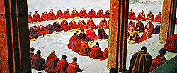 China, Huangzhong, 2005. A chilly afternoon does not prevent these monks from gathering for the afternoon lecture. The Kumbum Monastery, as it is also known, is a prominent center for the Gelukpa, or Yellow Hat sect of Tibetan Buddhism..