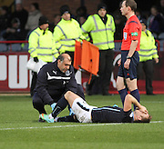 Dundee physio Niam Mohammed treates Greg Stewart  - Dundee v Inverness Caledonian Thistle, SPFL Premiership at Dens Park <br /> <br />  - &copy; David Young - www.davidyoungphoto.co.uk - email: davidyoungphoto@gmail.com