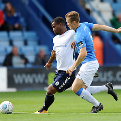 TELFORD COPYRIGHT MIKE SHERIDAN 15/9/2018 - Andre Brown of AFC Telford shoots under pressure from Dan Cowan of Stockport during the Vanarama Conference North fixture between AFC Telford United and Stockport County.