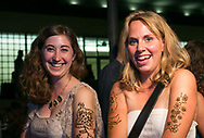 Students show off their henna designs at Sunburst Festival at Memorial Union Terrace in 2014.