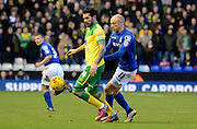 David Cotterill challenges Bradley Johnson during the Sky Bet Championship match between Birmingham City and Norwich City at St Andrews, Birmingham, England on 31 January 2015. Photo by Alan Franklin.