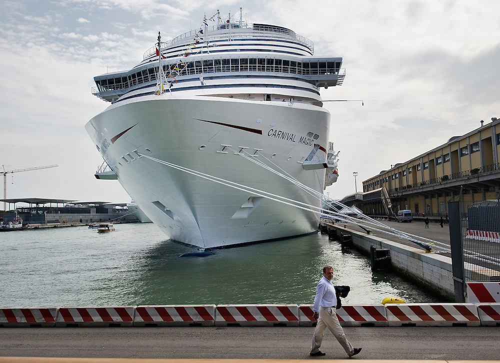 VENICE, ITALY - MAY 02: Cruise ship Carnival Magic is seen at the dock of Venice Cruise Terminal on the day is being officially named and starts her first cruise on May 1, 2011 in Venice, Italy. Giant cruise ships passing through  St Mark Basin and Giudecca Canal are causing continue controversy for the possible damages to the lagoon and Venice building