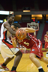 20 November 2010: Sidney Stahlberg crashes into defender Candace Sykes during an NCAA Womens basketball game between the Southern Illinois-Edwardsville Cougars and the Illinois State Redbirds at Redbird Arena in Normal Illinois.