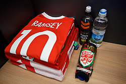 CARDIFF, WALES - Saturday, September 2, 2017: The Wales shirt and shin pads of Aaron Ramsey laid out in the dressing room before the 2018 FIFA World Cup Qualifying Group D match between Wales and Austria at the Cardiff City Stadium. (Pic by David Rawcliffe/Propaganda)