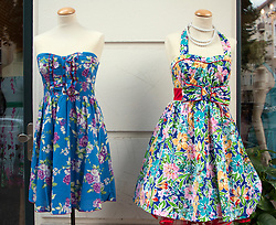 Two summer dresses on display outside small independent fashion boutique in bohemian Friedrichshain district of Berlin Germany