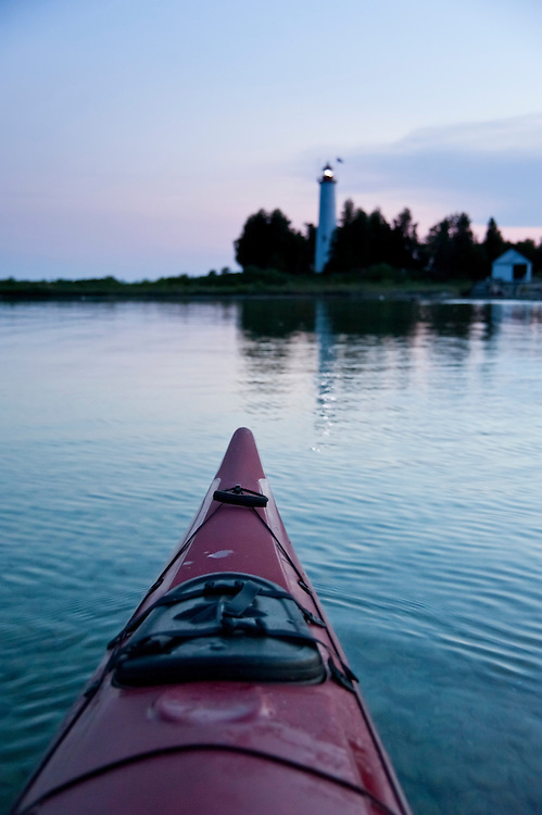 Point of view image while kayaking at dusk near St. Helena Island Lighthouse on Lake Michigan in the Straits of Mackinac..