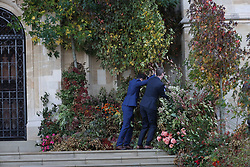 A fallen tree knocked over by high winds is placed back in position on the West Steps ahead of the wedding of Princess Eugenie to Jack Brooksbank at St George's Chapel in Windsor Castle.