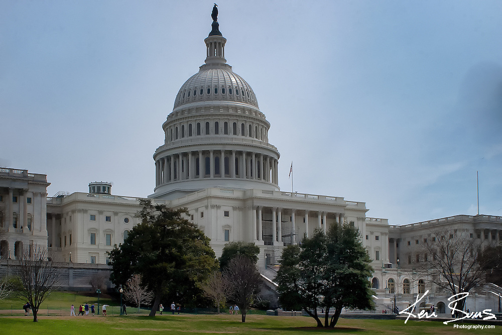 A photo of the west side of the United States Capital, which sits upon Capital Hill. It is located to the east end of the national mall and houses the United States Congress.