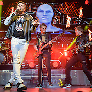 John Taylor and Simon Le Bon of Duran Duran perform at the Verizon Center with guitarist Dom Brown as part of their Paper Gods tour.