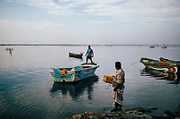 Jaffna, Sri Lanka -- February 8, 2018: Fishermen set out to sea in the early morning hours.