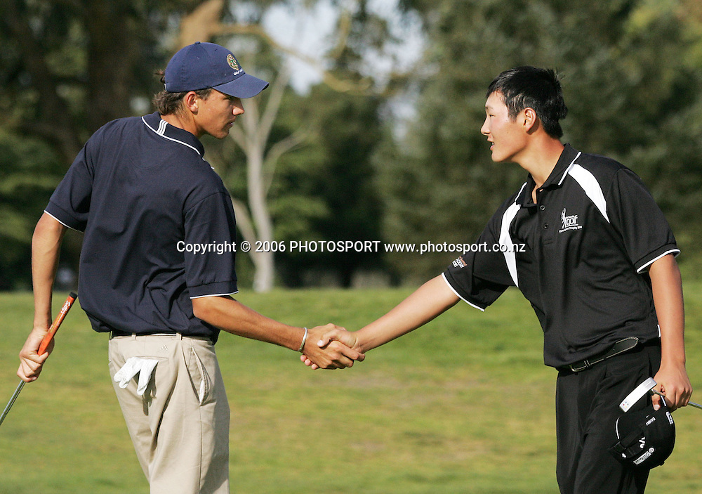 New Zealand's Danny Lee shakes hands with Australia's Matt Jager after their Clare Higson Trophy singles match at Hamilton Golf Club in Hamilton, New Zealand on Tuesday 26 September, 2006. Danny Lee won the match 2 and 1. Photo: Tim Hales/PHOTOSPORT