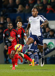 Saido Berahino of West Brom is challenged by Nathan Dyer of Swansea City - Photo mandatory by-line: Rogan Thomson/JMP - 07966 386802 - 11/02/2015 - SPORT - FOOTBALL - West Bromwich, England - The Hawthorns - West Bromwich Albion v Swansea City - Barclays Premier League.