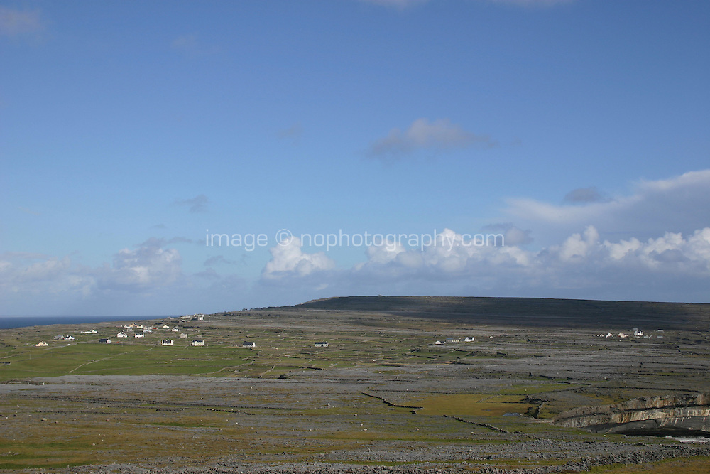 Landscape of Inis Mor the Aran Islands, Connemara, County Galway, Ireland. Blue sky, stone walls, scenic view