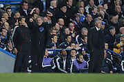 Jose Mourinho reacts as  Carlo Ancelotti watches from the sideline during the second leg of the round of 16 UEFA Champions League match at home to Chelsea at Stamford Bridge football stadium, London on March 16, 2010.
