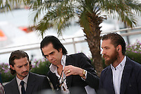 Shia Labeouf, Nick Cave, Tom Hardy at the Lawless film photocall at the 65th Cannes Film Festival. The screenplay for the film Lawless was written by Nick Cave and Directed by John Hillcoat. Saturday 19th May 2012 in Cannes Film Festival, France.