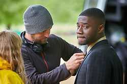 © Licensed to London News Pictures. 19/05/2015. OXFORD, UK. Filming of ITV drama Endeavour, telling the story of the early life of Inspector Morse, taking place in Christ Church Meadow in Oxford. <br /> <br /> In this picture: Actor Charles Babalola (right)<br /> <br /> Photo credit : Cliff Hide/LNP