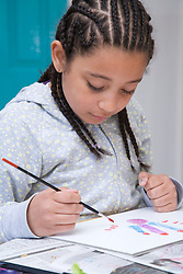 Little girl painting a picture,