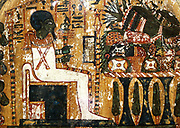 Limestone stele of Penbuwy. 19th Dynasty (approx. 1200 BC). Depicts the god Ptah seated in a shrine before a table heaped with food offerings.