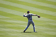 ANAHEIM, CA - JULY 10:  First baseman Justin Smoak #17 of the Seattle Mariners warms up during the game against the Los Angeles Angels of Anaheim on July 10, 2011 at Angel Stadium in Anaheim, California. (Photo by Paul Spinelli/MLB Photos via Getty Images) *** Local Caption *** Justin Smoak