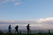 Ramblers or hikers traversing the skyline of the scarp slope of the North Downs early in the morning near Rochester in Kent, England, UK Thursday, May 1st 2008