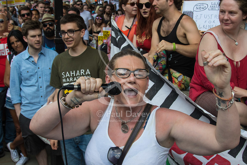 London, June 17th 2017. Protesters demonstrate against the Conservative's intended alliance with the Democratic Unionist Party (DUP) in Whitehall, London. The proposed pact will enable the Tories to maintain a small level of dominance in the House of commons after their majority was wiped out in the June 8th general election. PICTURED: A woman speaks on an open mic before the rally gets underway