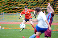Tessa Nicol of Football South watches the ball as Auckland Football shoot, prior to the ASB women's league match between Football South and Auckland Football, at the Caledonian Ground, Dunedin, New Zealand,  20 October 2013. Credit: Joe Allison / allisonimages.co.nz
