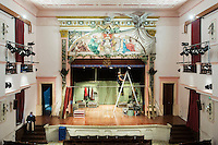SLIEMA, MALTA - 8 FEBRUARY 2016: Technicians set up the lighting for the touring Hamlet, performed by the Shakespeare's Globe theatre company, at the Salesian Theatre in Sliema, Malta, on February 8th 2016.<br /> <br /> The touring Hamlet, performed by the Shakespeare's Globe theatre company, is part of the Globe to Globe tour that set off in April 2014 (on the 450th anniversary of Shakespeare's birth) with the ambitious intention of visiting every country in the world over 2 years. The crew is composed of a total of sixteen men and women: four stage managers and twelve twelve actors  actors perform over two dozen parts on a stripped-down wooden stage. So far Hamlet has been performed in over 150 countries, to more than 100,000 people and travelled over 150,000 miles. The tour was granted UNESCO patronage for its engagement with local communities and its promotion of cultural education. Hamlet was also played for many dsiplaced people around the world. It was performed in the Zaatari camp on the border between Syria and Jordan, for Central African Republic refugees in Cameroon, and for Yemeni people in Djibouti. On February 3rd it was performed to about 300 refugees in Calais at the camp known as the Jungle.