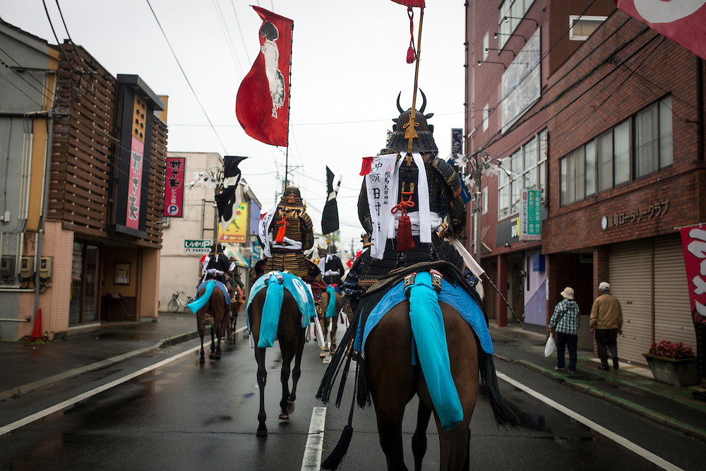 "MINAMISOMA, JAPAN - JULY 24 :  A samurai horsemen is seen in the street during ""Hon Matsuri"" parade, Soma Nomaoi festival at Minamisoma city on Sunday, July 24, 2016 in Fukushima Prefecture, Japan. ""Soma-Nomaoi"" is a three day traditional festival that recreates a samurai battle scene from more than 1,000 years ago. The festival has gathered more than thousands visitors as Fukushima still continues to recovery from the 2011 nuclear disaster, the samurai warriors battles for recovery of the area. (Photo: Richard Atrero de Guzman/NURPhoto)"