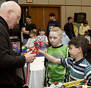 Dick Rathbun (left,) from Centerville talks to Austin Coccia, 10, from Jamestown (center) and Stefan Speck, 9, from Troy during the 5th Annual TechFest at Sinclair Community College, Saturday afternoon.  This is Stefan's third time at the TechFest, and he has aspirations to be a robotic engineer, according to his father, Michael.