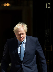© Licensed to London News Pictures. 06/08/2019. London, UK. Prime Minister Boris Johnson walks out from Number 10 Downing Street to meet with Prime Minister of Estonia, Jüri Ratas. Photo credit: Peter Macdiarmid/LNP