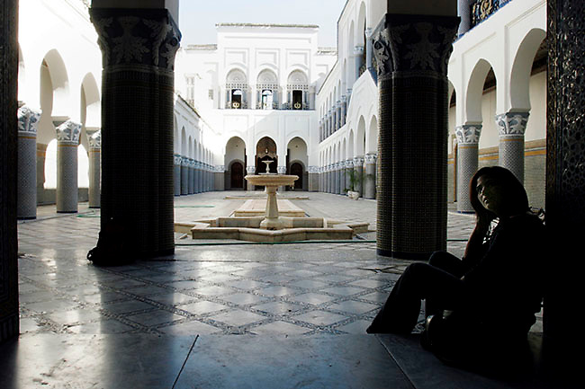 Karima el-Bakkuchi, a native from Fes, Morocco, waits in the courtyard of Palais el-Moukri, an old palace turned into a performance hall and hostel. A group of Sufi musicians were performing for a group of tourists on this Sunday afternoon, June 03, 2007. (PHOTO BY TIMOTHY D. BURDICK).
